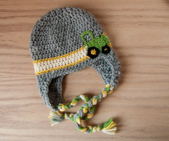 Crochet John Deere tractor baby hat with ear flaps.
