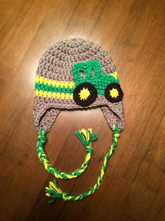 Crochet John Deere tractor baby hat with ear flaps.