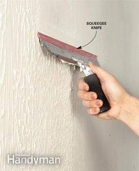 <strong>Step 3:</strong> Wipe it smooth -   How to skim coat to get rid of textured walls.