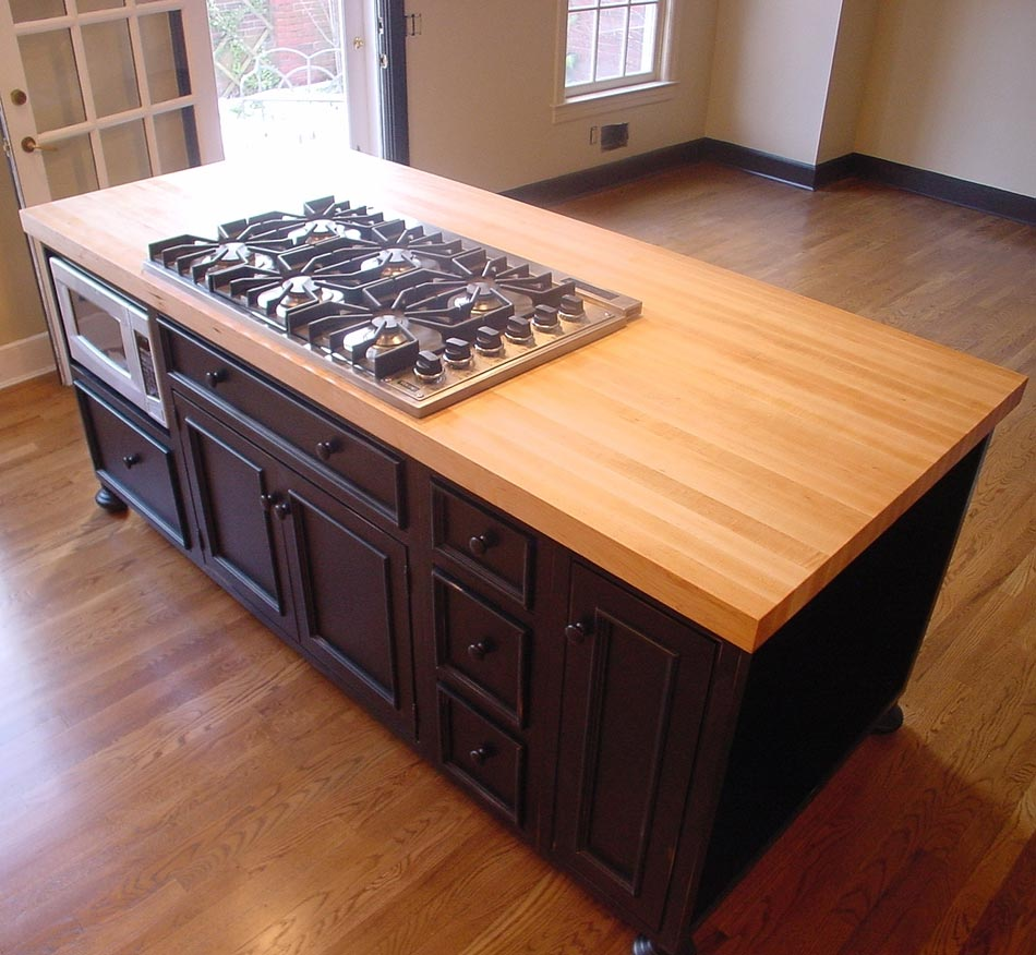 black-wooden-kitchen-island-with-butcher-block-countertop-and-stove-for-modern-kitchen-furniture-idea