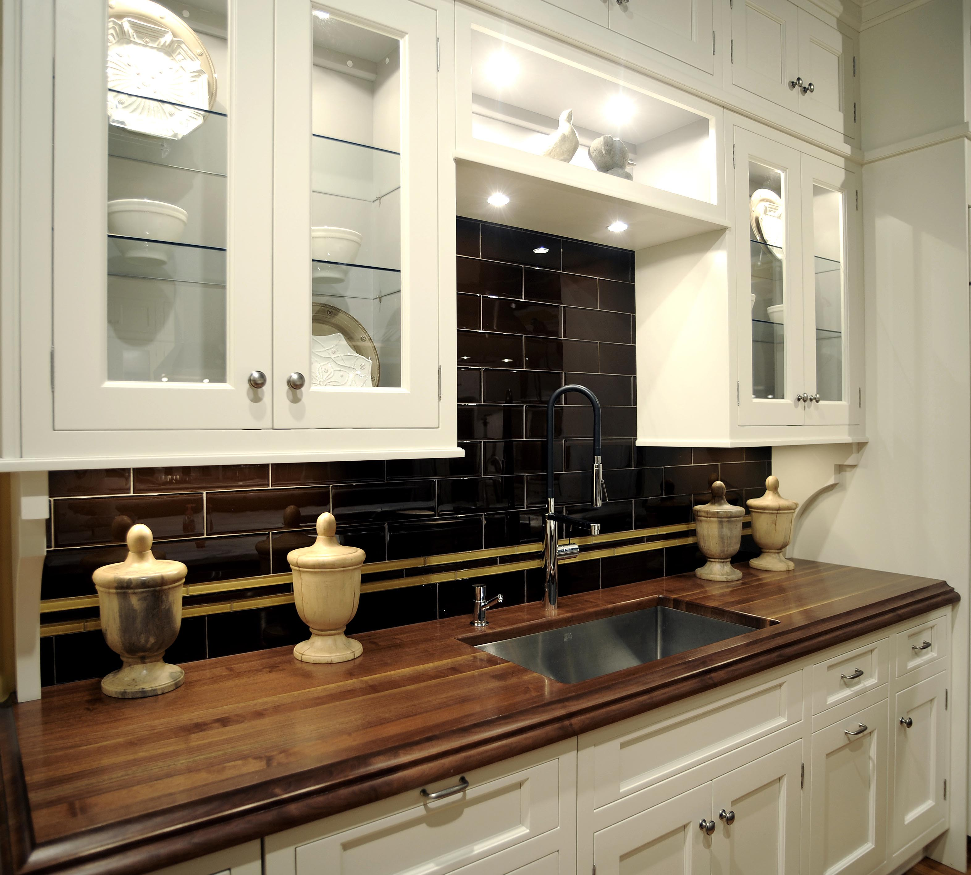 white-wooden-kitchen-cabinet-with-butcher-block-countertop-and-elegant-black-tile-backsplash-for-modern-kitchen-decor-idea